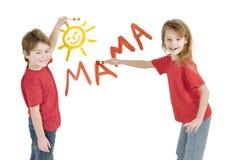 Kids writing word Mama. Little kids writing word Mama Royalty Free Stock Images