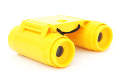 Kids yellow plastic binoculars Royalty Free Stock Photography