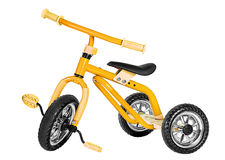 Kids yellow tricycle Stock Photo