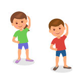 Kids yoga. Boy and girl standing perform gymnastic exercises. Stock Photos