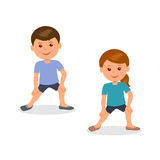 Kids yoga. Boy and girl standing perform gymnastic exercises. Stock Photo
