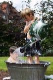 Kids in zinc bathtub Stock Photos
