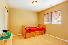 Kidss room with wooden bed Royalty Free Stock Photography