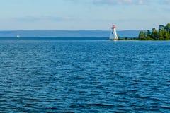 Kidston Island Lighthouse, in Cape Breton. The Kidston Island Lighthouse and a sail boat, in Cape Breton Island, Nova Scotia, Canada royalty free stock photo