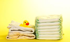 Kidswear, disposable diapers and rubber duckling Royalty Free Stock Image