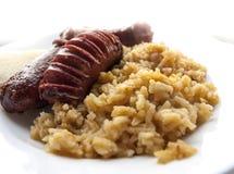 Kiełbasy i ryż Obrazy Royalty Free