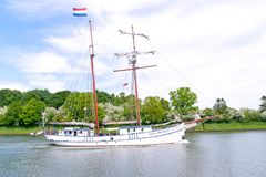 Kiel Canal, Germany - May 18, 2014 The ocean-goinig sailing ship Flying Dutchman, a converted logger for herring fishing, passes stock photos