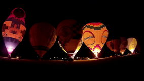 KIEL, GERMANY - JUNI 22, 2016: Glowing Hot Air Balloons in the Night Glow on the 10. International Balloon Sail in Kiel, Germany stock footage