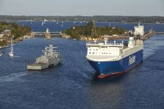 Kiel - Ro-Ro cargo ship and naval vessel at Kiel Canal Stock Photos