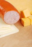 Kielbasa with two types of cheese Royalty Free Stock Images