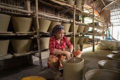 Kien Giang, Vietnam - Dec 6, 2016: Vietnamese woman making clay pots - pottery product by hands in Hon Dat district, Kien Giang pr stock photos