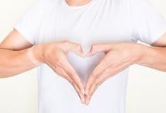 Kierowe kształt ręki na lewej strony klatce piersiowej Obrazy Stock