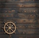 Kierownica na ciemnym drewnianym tle Zdjęcia Stock