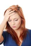 kierownicza ręki migrena kobieta jej mienie Zdjęcie Royalty Free