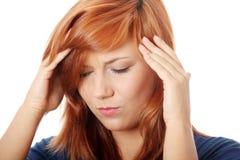 kierownicza ręki migrena kobieta jej mienie Zdjęcia Royalty Free