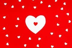 Kierowy kształt na czerwonym tło walentynki ` s dnia pomysle Zdjęcie Stock