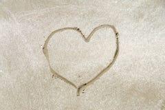 Kierowy kształta symbol rysujący na piasku Obrazy Stock
