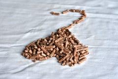 Kierowy kształtny drewniany wyrka paliwo na białym tle Zdjęcia Royalty Free
