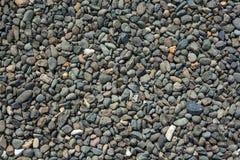 Kiesbeschaffenheit Kieshintergrund Kleine rote Steine Stockfotografie
