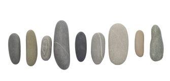 Kieselsteine auf Weiß Stockfotos