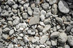 Kieselsteinnahaufnahme auf dem Ufer lizenzfreies stockfoto