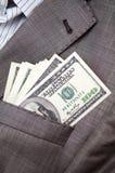 kieszeń kostiumów biznesowi dolary obraz stock
