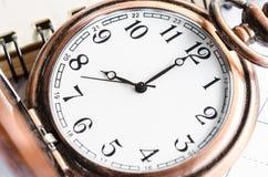 Kieszeniowy zegarek na dzienniczek stronie Obraz Royalty Free