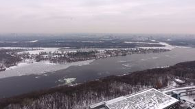 Kiev aerial view. Video from the air. Winter snow. City Kiev, Ukraine. Frozen Dnepr River, the helipad. Panorama of the stock video