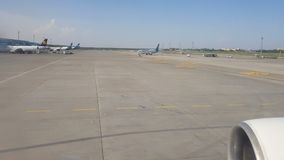Kiev, Borispol, Ukraine - May 02, 2018: View from the window of a plane moving at the airport. Preparing for takeoff stock video