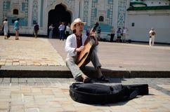 Kiev busker. Guy playing the bandura at Sophia Square in Kiev, Ukraine Royalty Free Stock Photos
