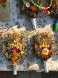 Bouquets of religious flowers are sold on the street in Kyiv or Kiev Ukraine. Kiev is the capital city of Ukraine, bisected by the Dnieper River and known for Stock Photo
