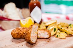 Kiev chicken with idaho potatoes on wooden board Royalty Free Stock Images