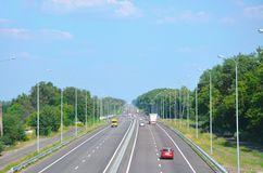 Kiev-Chop highway in the afternoon with cars, view into the dist stock photos