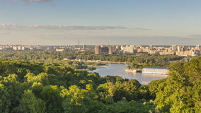 Kiev cityscape view. Time lapse of cloudscape over the scenic cityscape of Kiev with shadows moving over green trees stock video footage