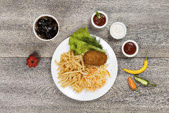 Kiev cutlet with french fries Stock Photos