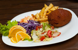 Kiev cutlet with salad Stock Images