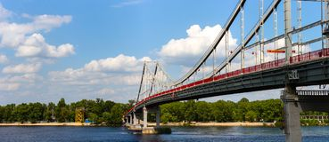 Kiev Footbridge over the Dnieper. Calmness and balance between nature and modern architecture. This photo was shot from the bank of the Dnieper, it consists of Stock Images