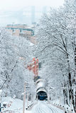 Kiev funicular. The cable car, driving on snow-covered park Stock Photos