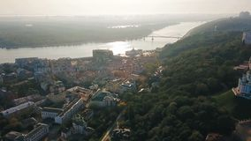Kiev Kiyv Ukraine aeriel video footage. Camera moves from river Dnepr to Andriyivskyy Descent and St.Andrew`s Church. Morning sunrise backlight stock video footage