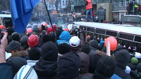 Kiev. Maidan. Huge crowd of protesters pushing the bus at a police barrier stock video
