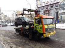Kiev, March 6, 2018, Ukraine. Traffic police officers on street to pick up intruder`s car on tow truck. Loading tow truck car of. Kiev, March 6, 2018, Ukraine royalty free stock images