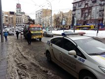 Kiev, March 6, 2018, Ukraine. Traffic police officers on street to pick up intruder`s car on tow truck. Loading tow truck car of. Kiev, March 6, 2018, Ukraine royalty free stock photography