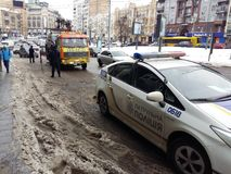 Kiev, March 6, 2018, Ukraine. Traffic police officers on street to pick up intruder`s car on tow truck. Loading tow truck car of. Kiev, March 6, 2018, Ukraine stock image