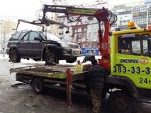 Kiev, March 6, 2018, Ukraine. Traffic police officers on street to pick up intruder`s car on tow truck. Loading tow truck car of. Kiev, March 6, 2018, Ukraine stock photography