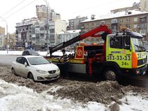 Kiev, March 6, 2018, Ukraine. Traffic police officers on street to pick up intruder`s car on tow truck. Loading tow truck car of. Kiev, March 6, 2018, Ukraine royalty free stock photo