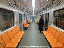 Kiev metro. Orange seats underground and supervisor of the train Stock Images