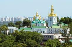 Kiev-Pechersk Lavra. Beautiful golden domes of Kiev-Pechersk Lavra in Ukraine and view on Dnepr Royalty Free Stock Photography