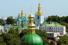 Kiev-Pechersk Lavra. Beautiful golden domes of Kiev-Pechersk Lavra in Ukraine and view on Dnepr Stock Images