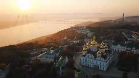 Kiev Pechersk Lavra Ukraine. Aerial drone video footage. View to rider Dnipro and The Motherland Monument. Fog and. Sunrise light. the camera takes off from the stock footage