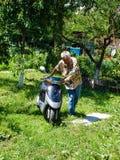 Kiev region, ukraine - july 12. 2009: man driving motorcycle to travel. Driving motorcycle to travel stock photography